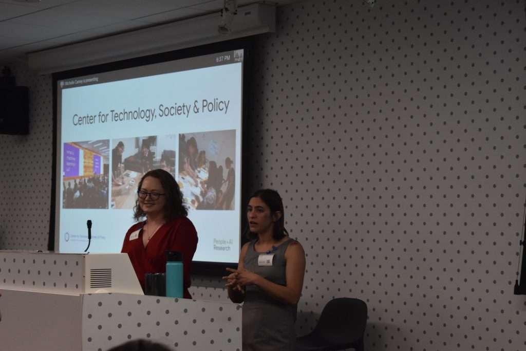 "CTSP Co-Directors Elizabeth Resor and Anne Jonas present in front of a slide that says ""Center for Technology, Society & Policy"" with a few images from CTSP projects"